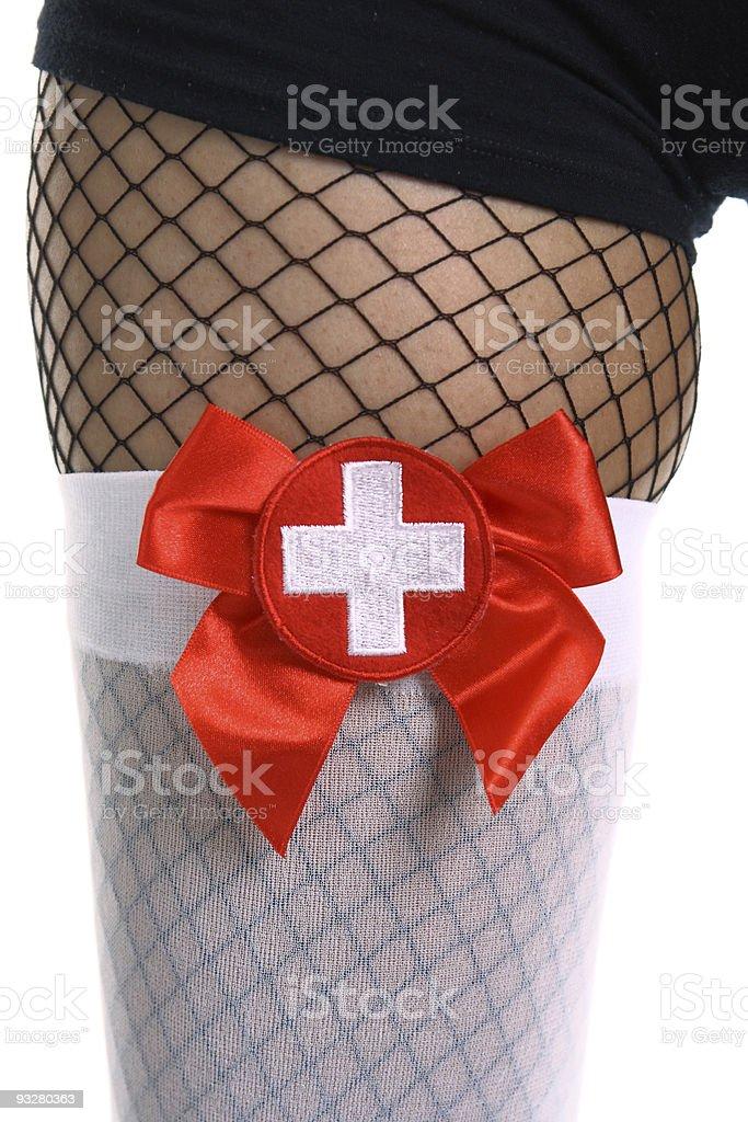 sexy nurse's leg in fishnets royalty-free stock photo