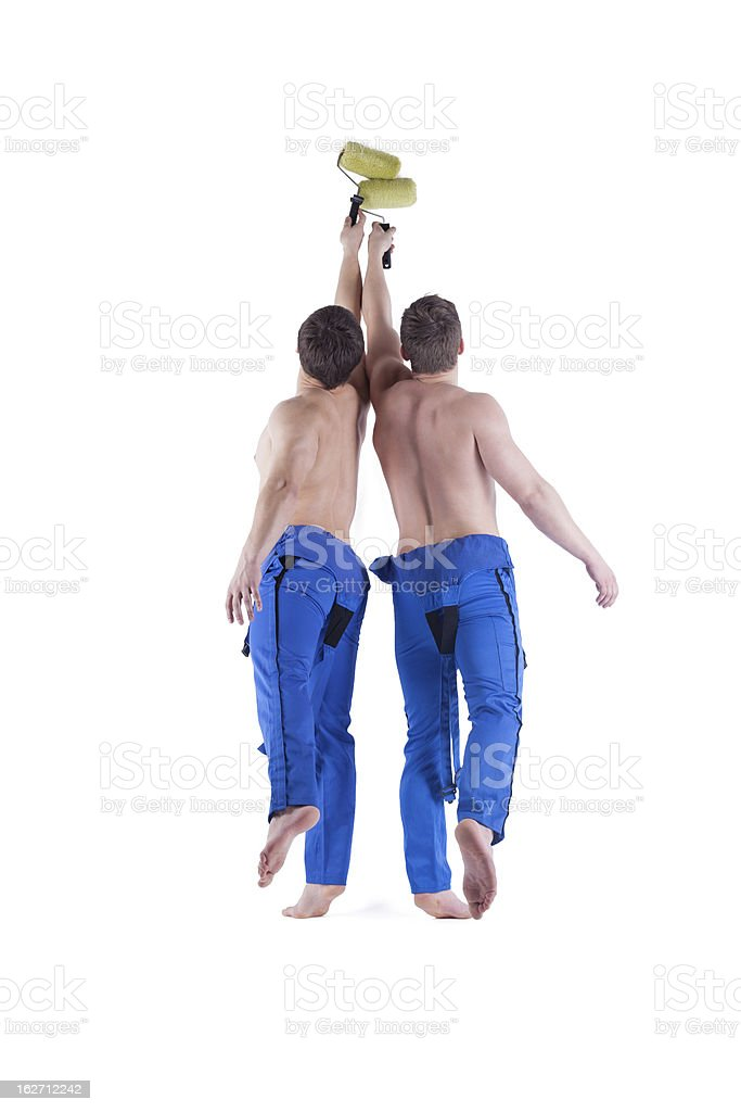 Sexy painters in blue overalls royalty-free stock photo