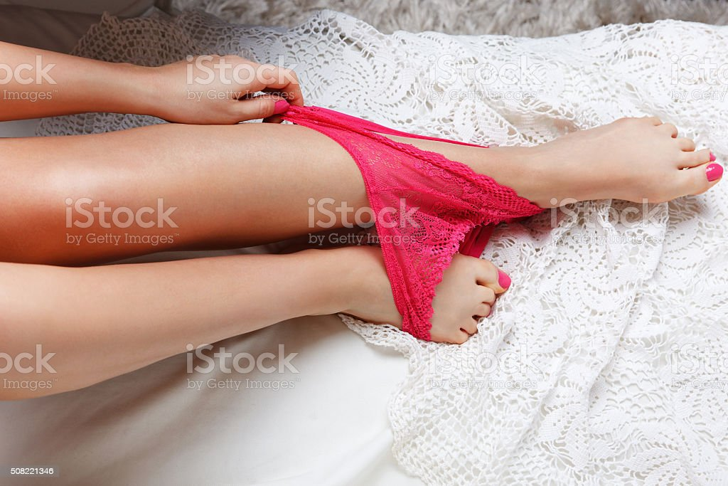 Sexy panties on a woman's feet stock photo
