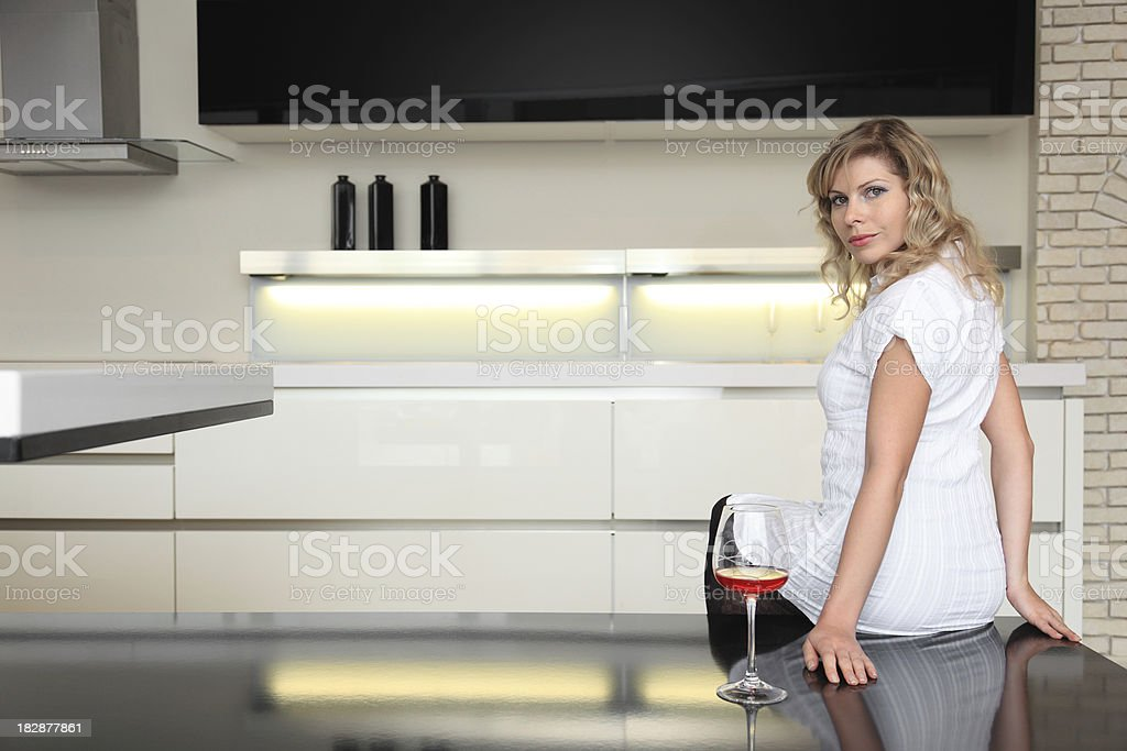 Sexy Pensive Woman on the kitchen table royalty-free stock photo