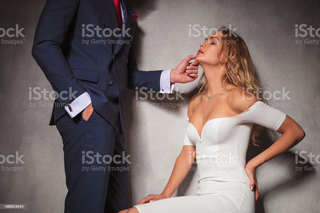 sexy picture of a gentleman holding his woman by  chin stock photo