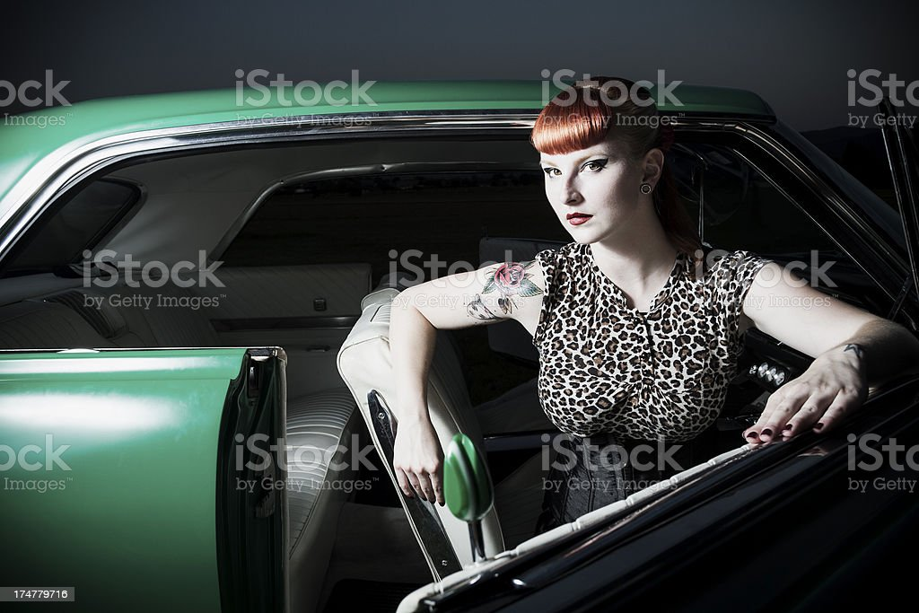 Sexy pin up girl in a car stock photo