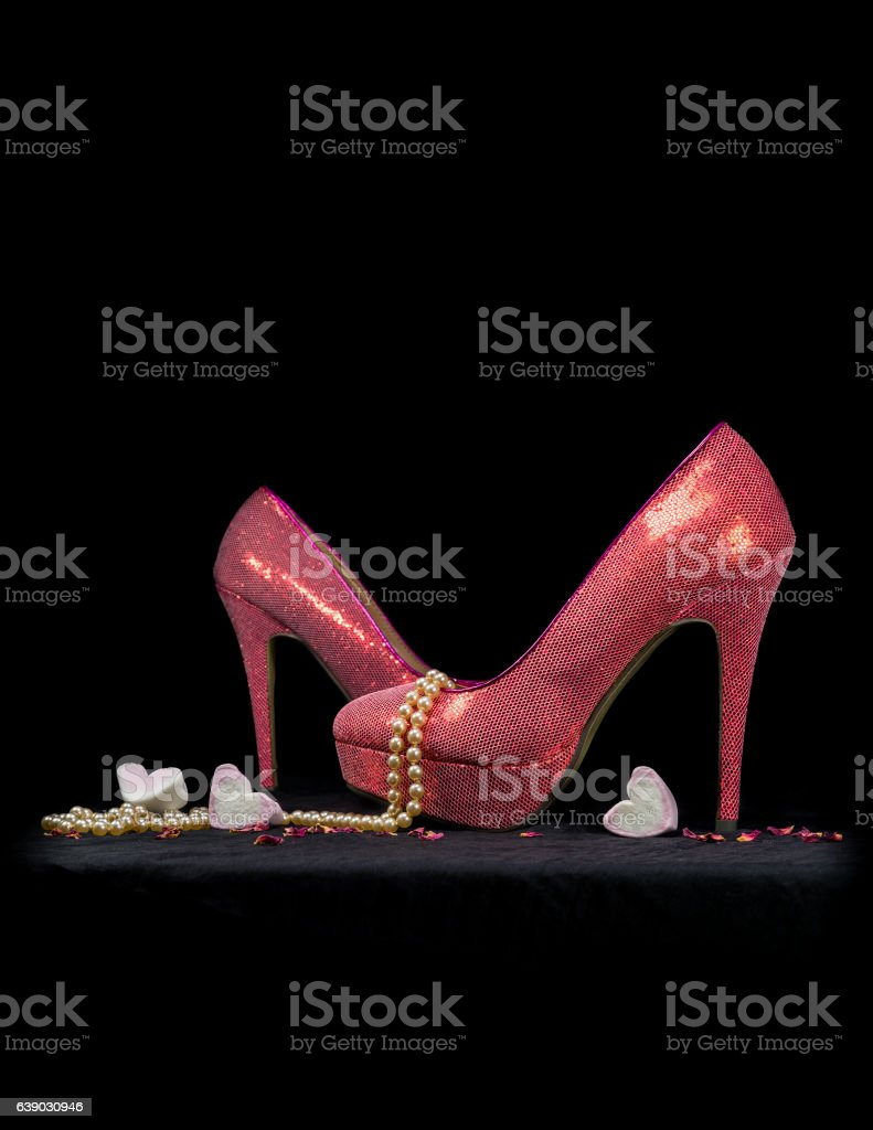 Sexy pink stiletto shoes with pearls and hearts. stock photo