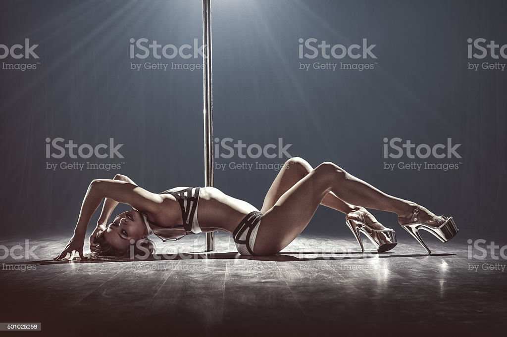 sexy pole dancer stock photo
