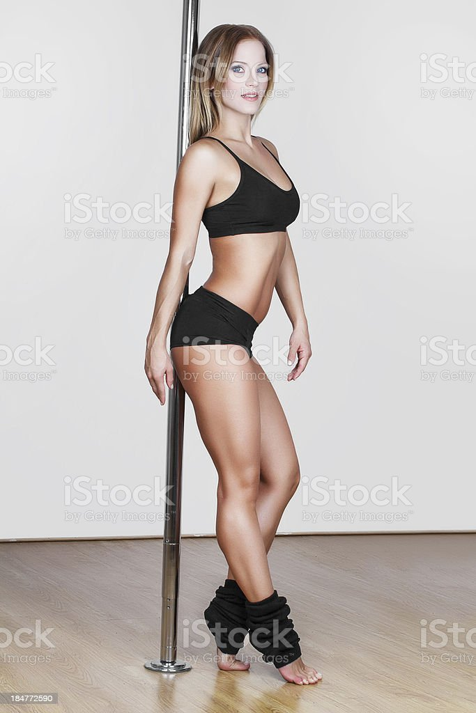Sexy pole dancer posing royalty-free stock photo