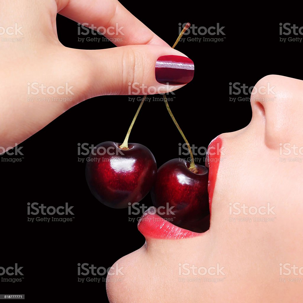 Sexy Red Lips with Cherry over black stock photo
