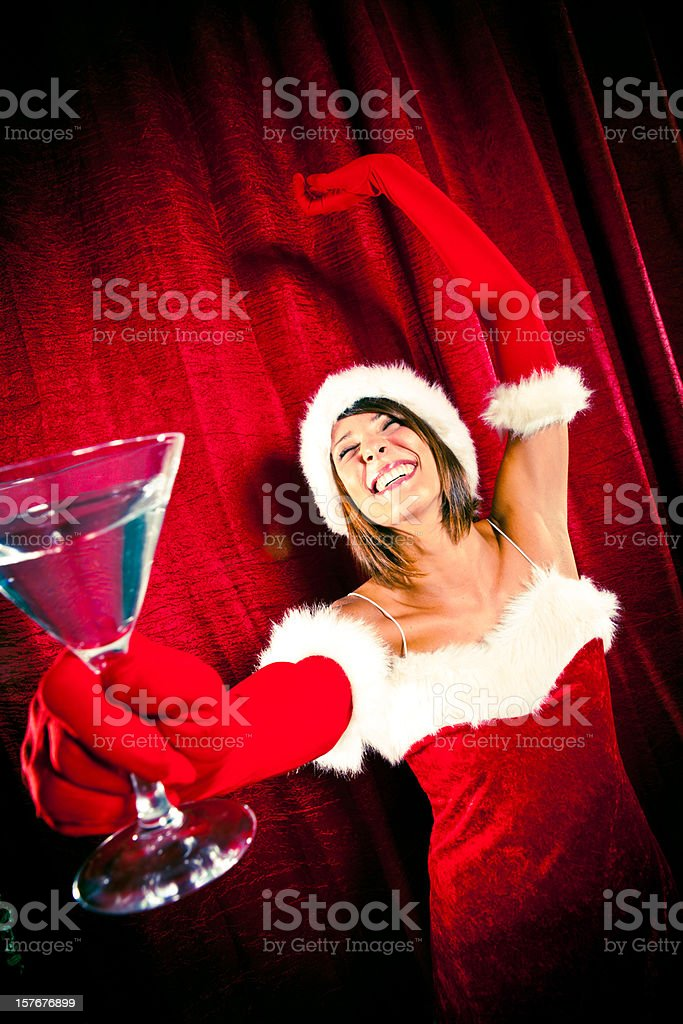 sexy red santa girl dance with cup at  christmas party royalty-free stock photo