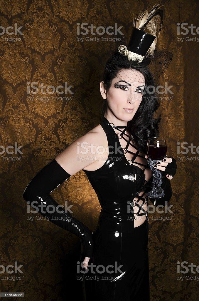 Sexy Retro Cabaret - Glamorous Vixen with Gothic Glass royalty-free stock photo