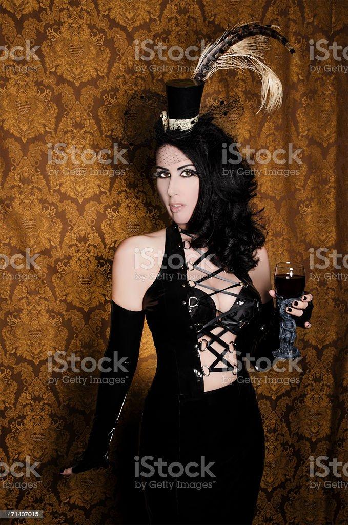 Sexy Retro Cabaret - Glamorous Vixen with Gothic Glass stock photo