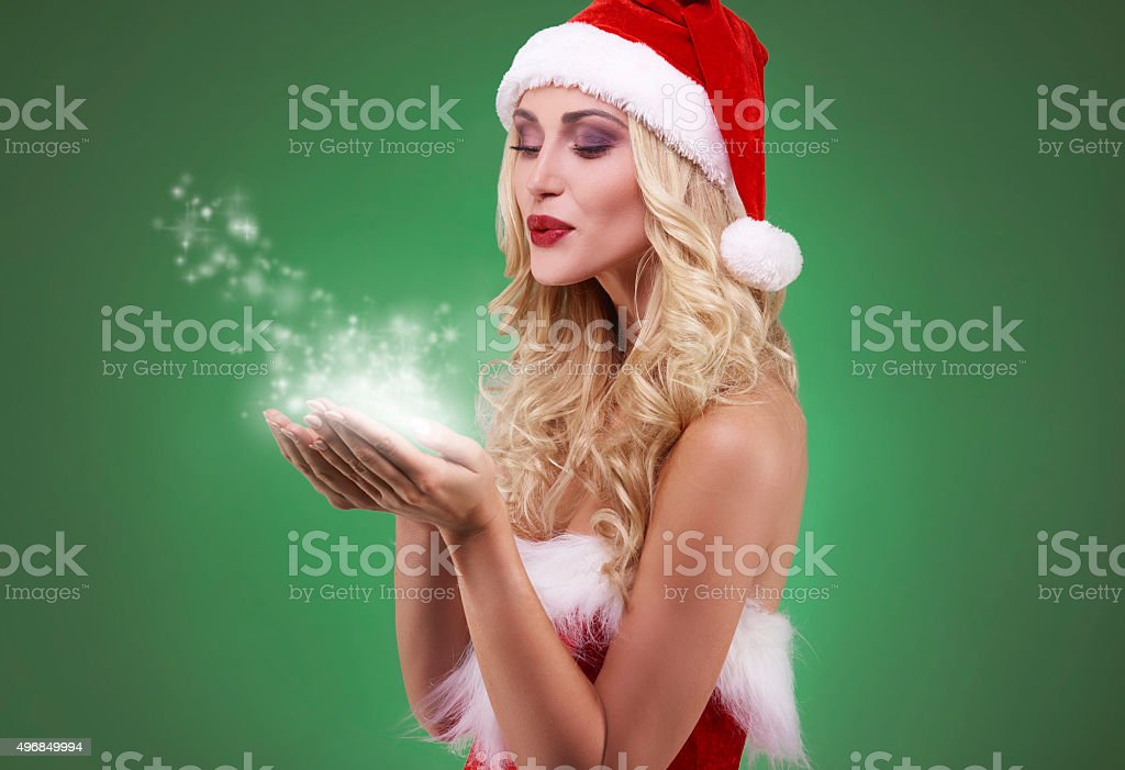Sexy santa with magic stars in hands stock photo