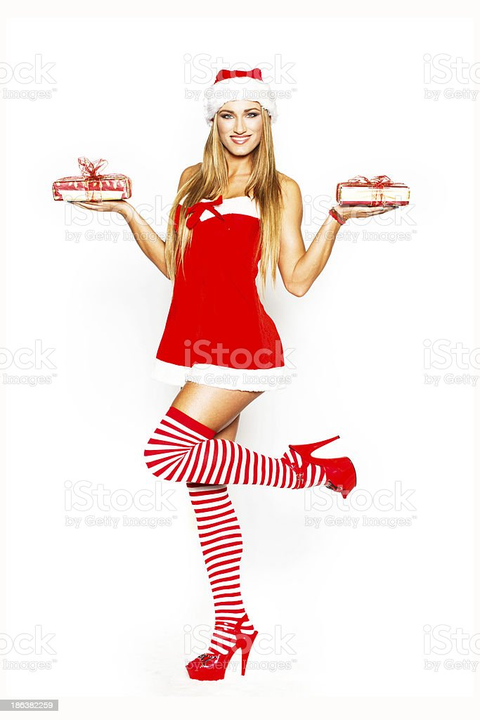 Sexy santa woman holding gift packages royalty-free stock photo