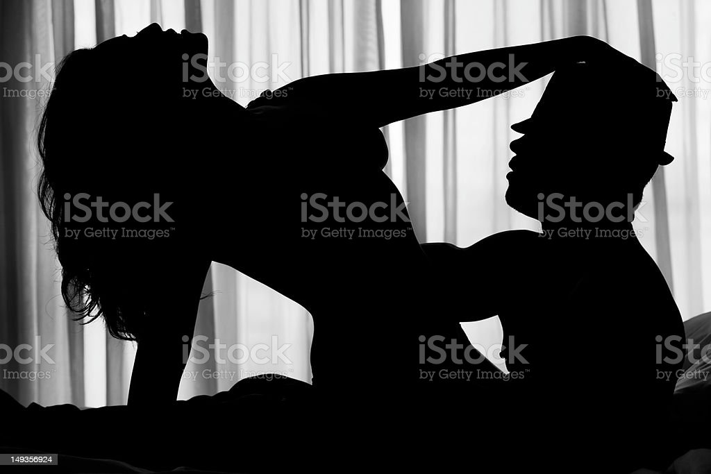 Sexy silhouette of a couple stock photo