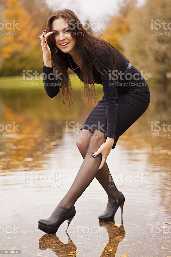 Sexy smiling lady in autumn park stock photo