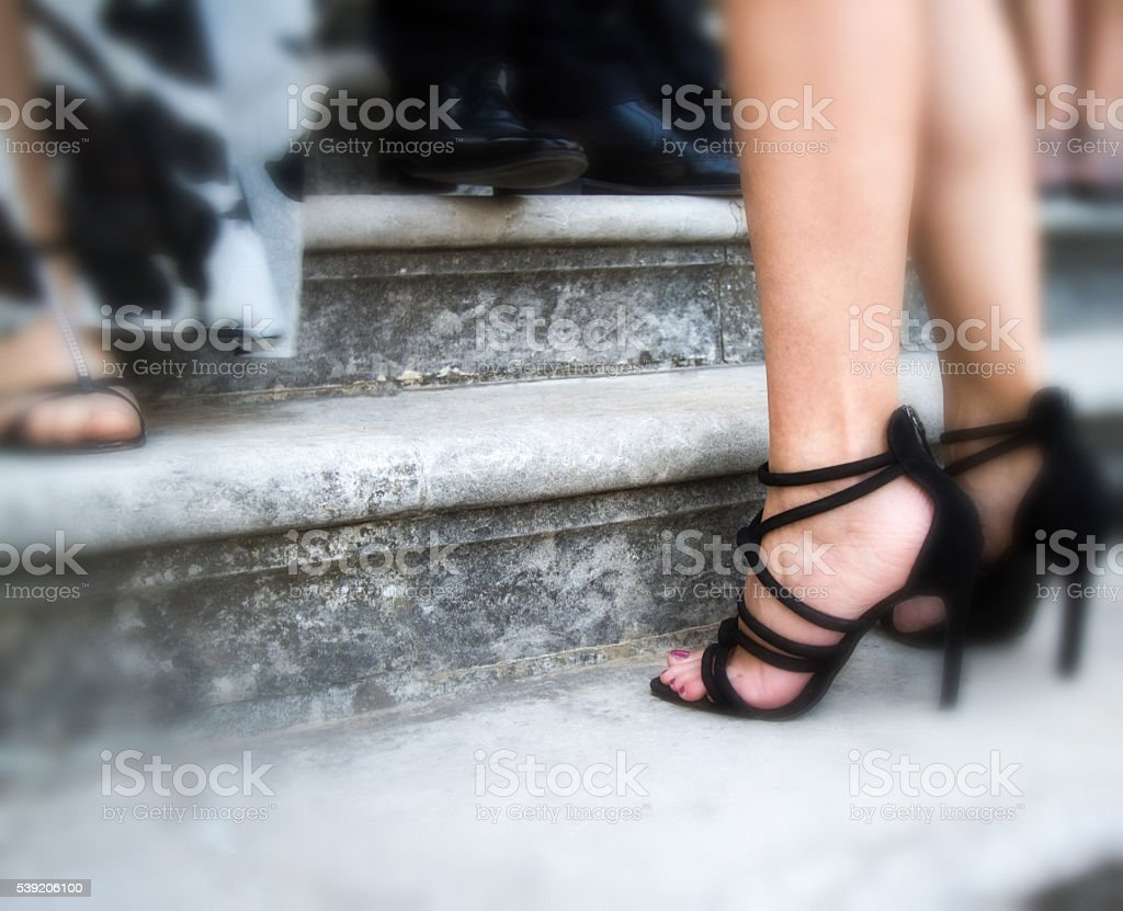 Sexy Strappy Black Stilettos On Stone Steps (Close-Up) stock photo
