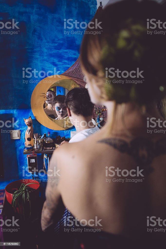 Sexy Sugar Skulls in Moon-shaped mirror stock photo