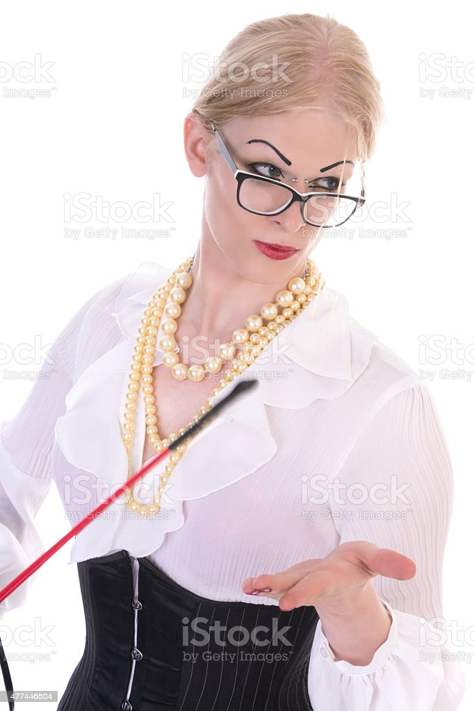 Sexy transgender secretary with riding crop, looking to side. stock photo