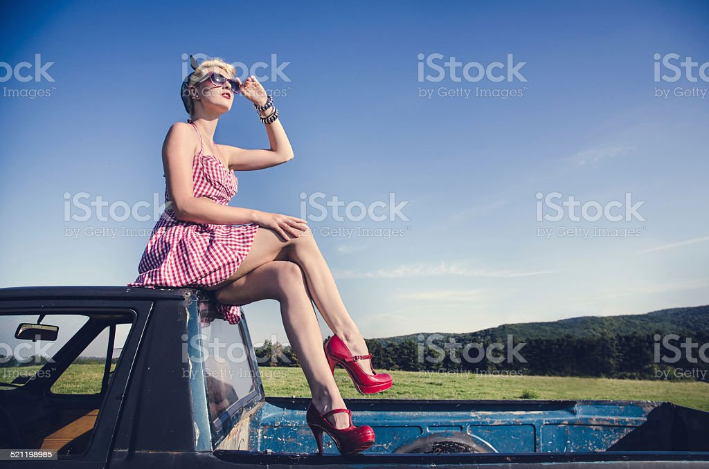 Sexy vintage female model outdoors stock photo
