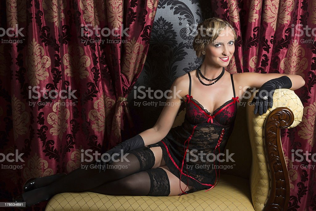 Sexy on a chaise-longue royalty-free stock photo