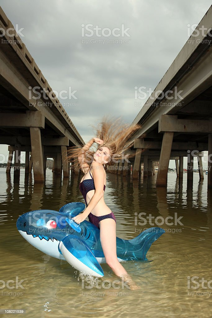 Sexy Wet Woman takes Wild Ride on Shark Raft royalty-free stock photo