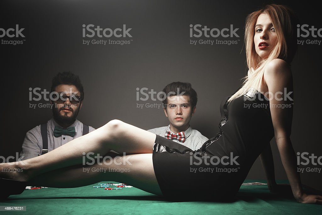 Sexy woman and gambler stock photo