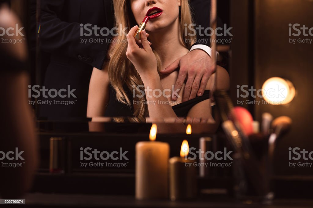 Sexy woman applying red lipstic stock photo