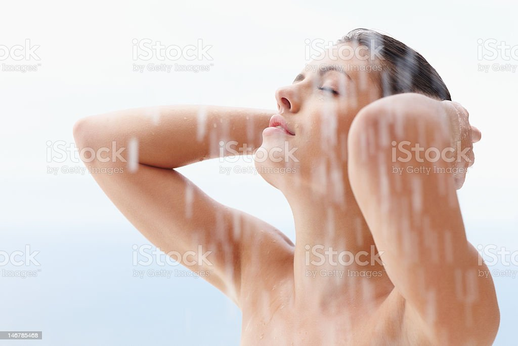 Sexy woman bathing under an outdoor shower royalty-free stock photo