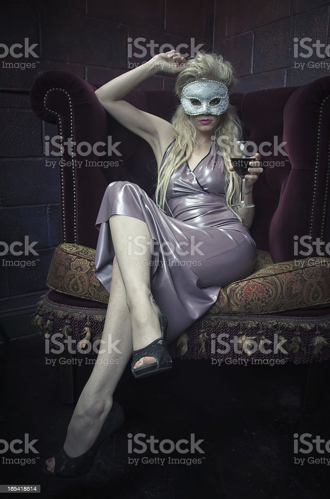 Sexy Woman Drinking Wine and Wearing a Venetian Mask royalty-free stock photo