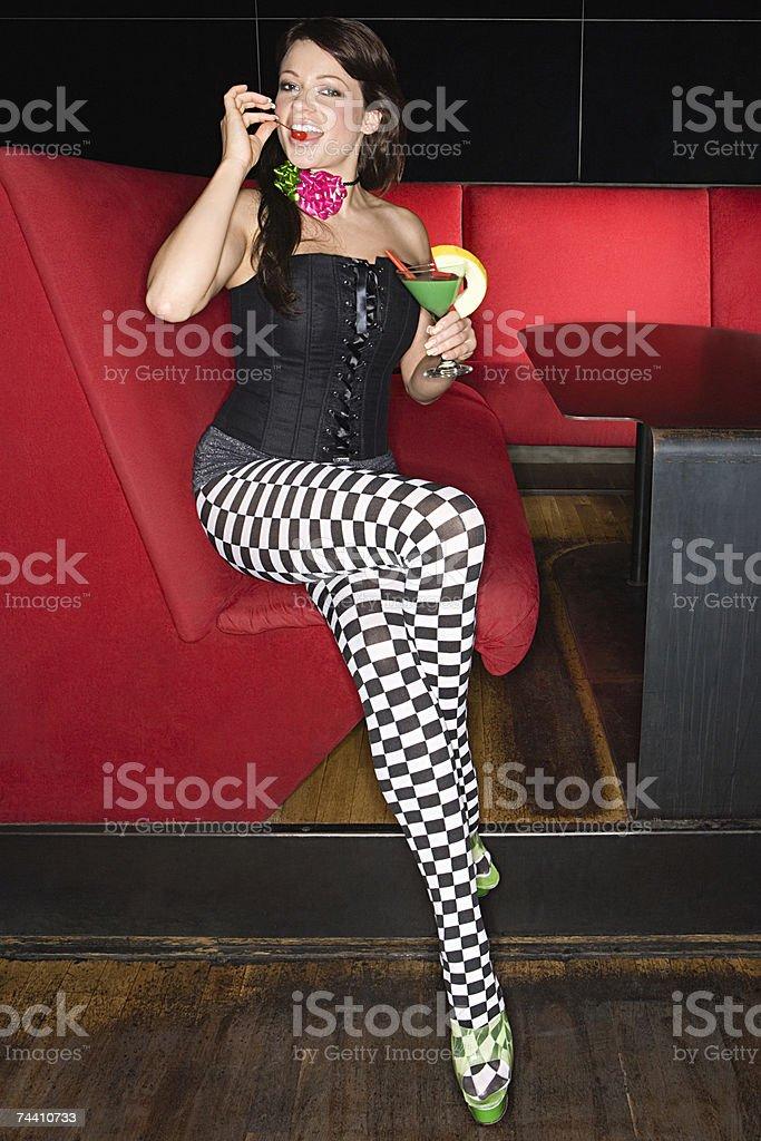 Sexy woman eating cherry stock photo