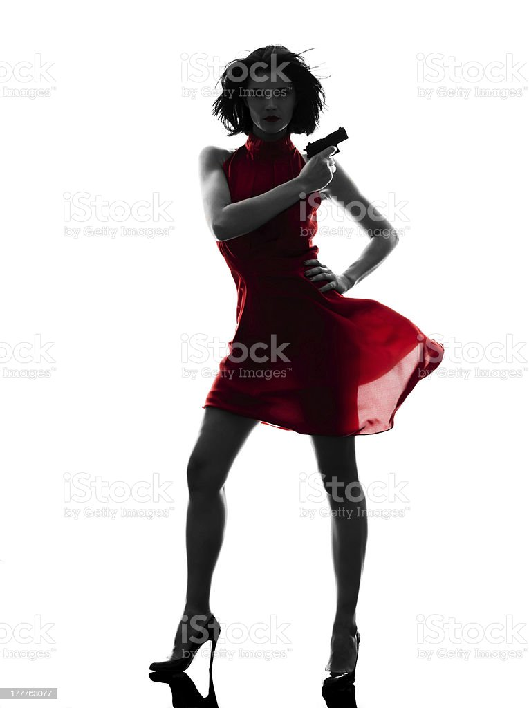 sexy woman holding gun  silhouette stock photo