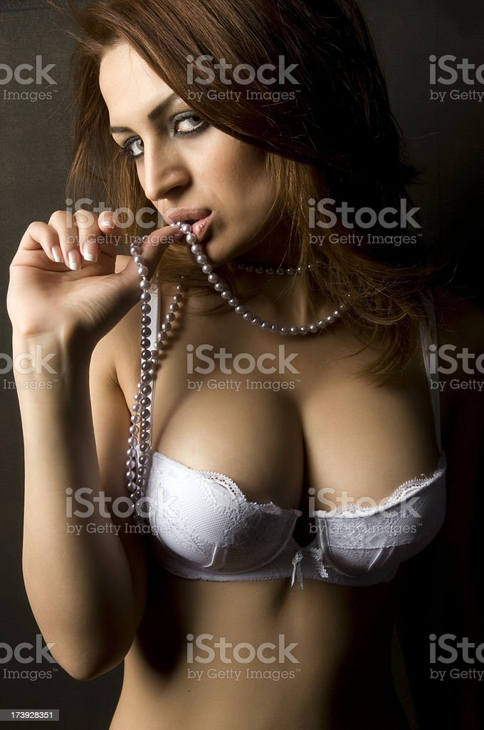 Sexy woman holding pearl necklace royalty-free stock photo