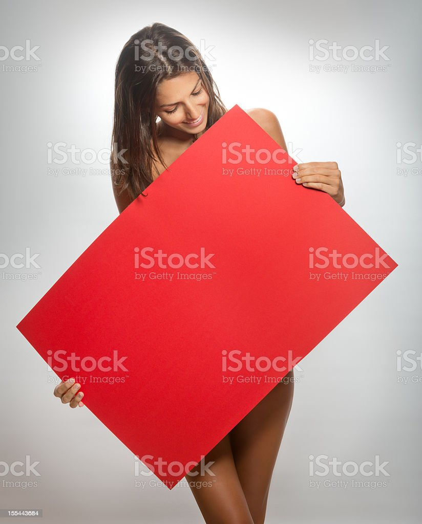 Sexy Woman Holding Up Blank Billboard with Copy Space (XXXL) royalty-free stock photo