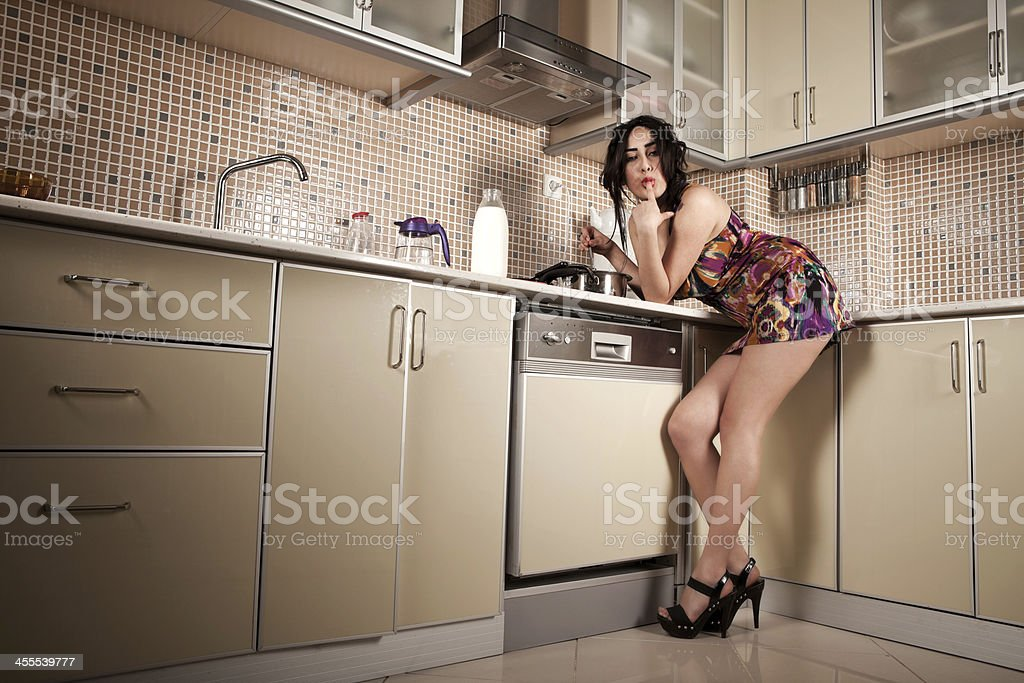 Sexy Woman in a Kitchen royalty-free stock photo