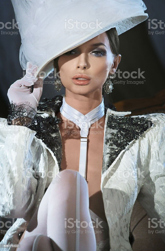 Sexy woman in a white clothing and hat stock photo