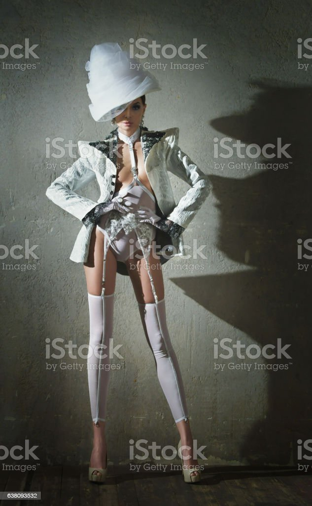 Sexy woman in a white lingerie and hat stock photo