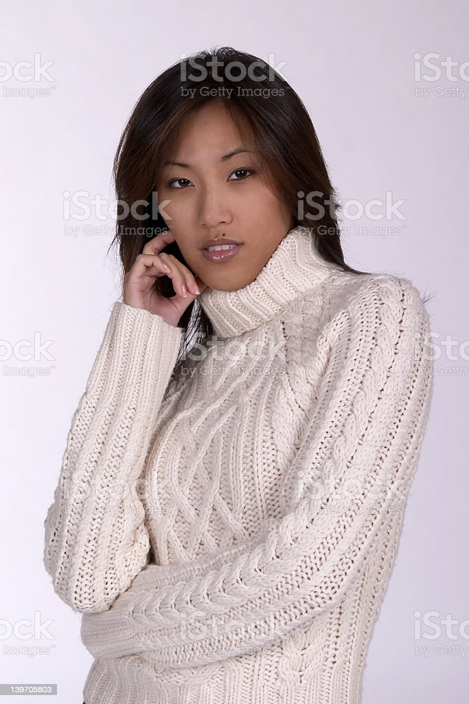 Sexy woman in cable knit sweater stock photo