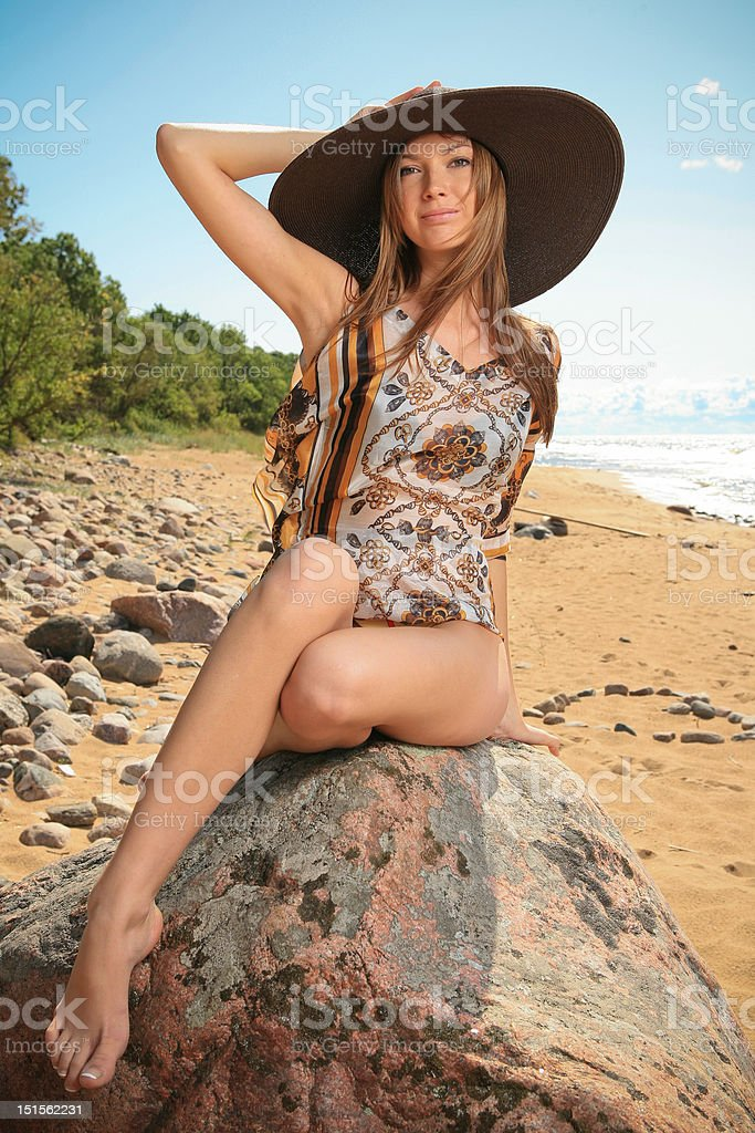 Sexy woman in hat and bikini royalty-free stock photo