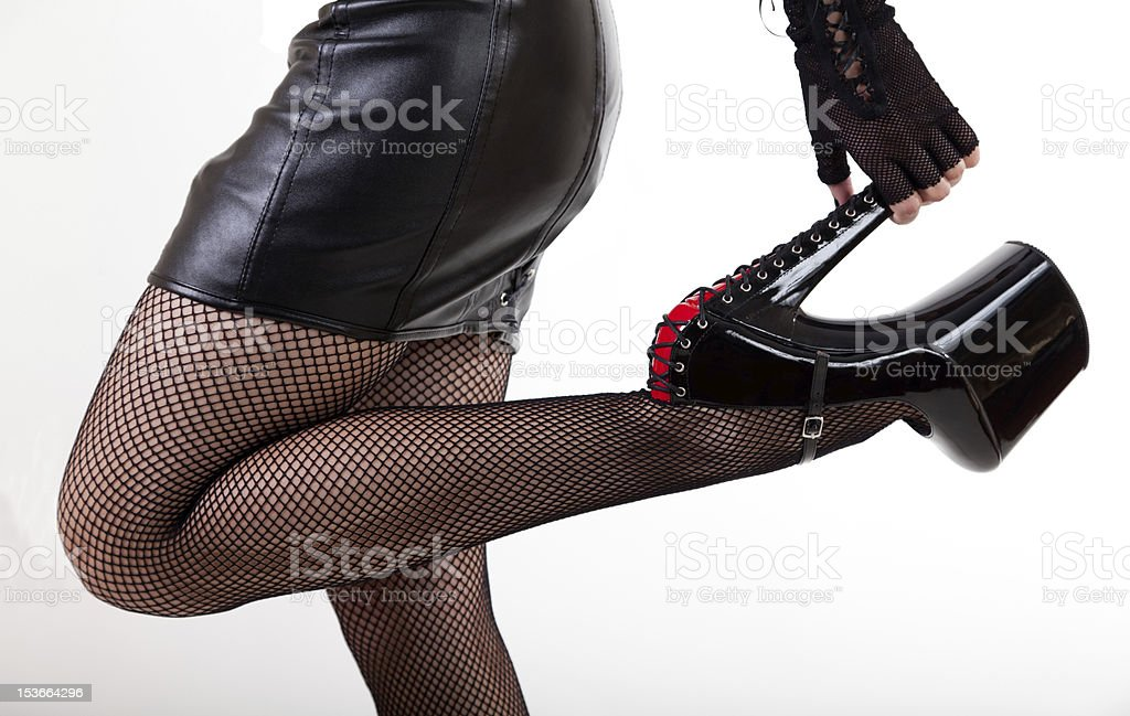 Sexy woman in high-heeled fetish shoes royalty-free stock photo