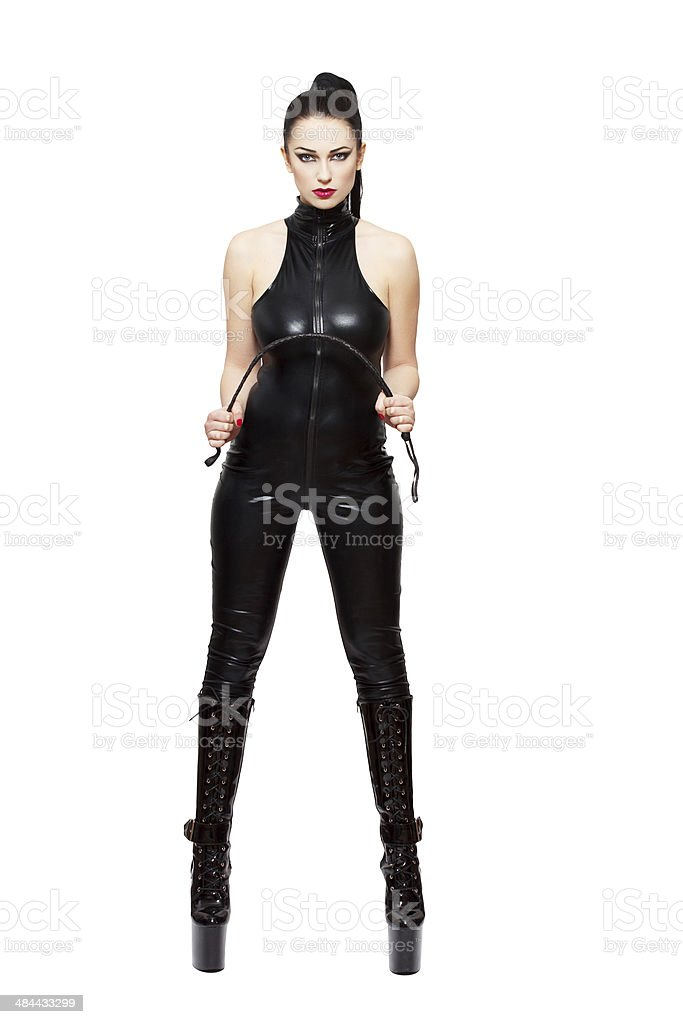 Sexy woman in latex catsuit and whip stock photo