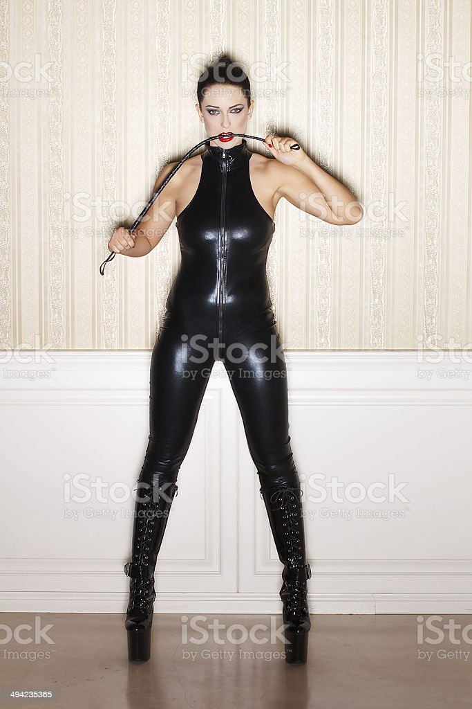 Sexy woman in latex catsuit royalty-free stock photo