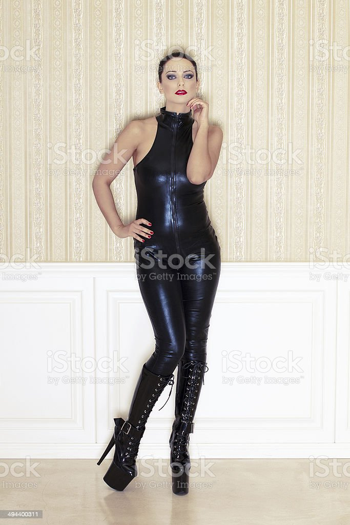 Sexy woman in latex catsuit posing royalty-free stock photo