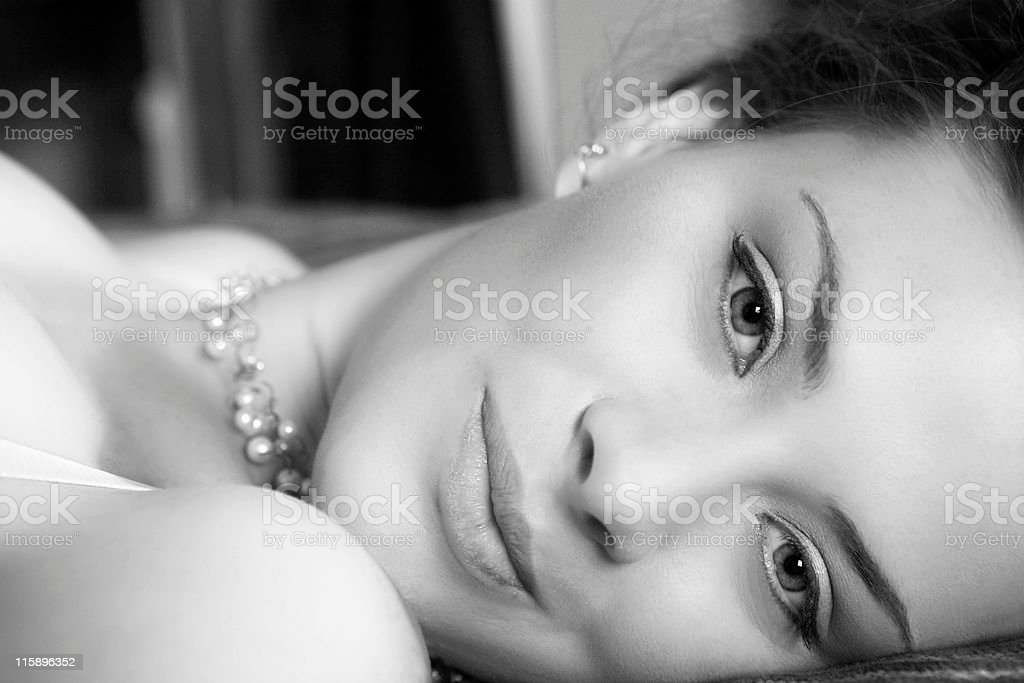 Sexy woman in Lingerie lying on a bed royalty-free stock photo