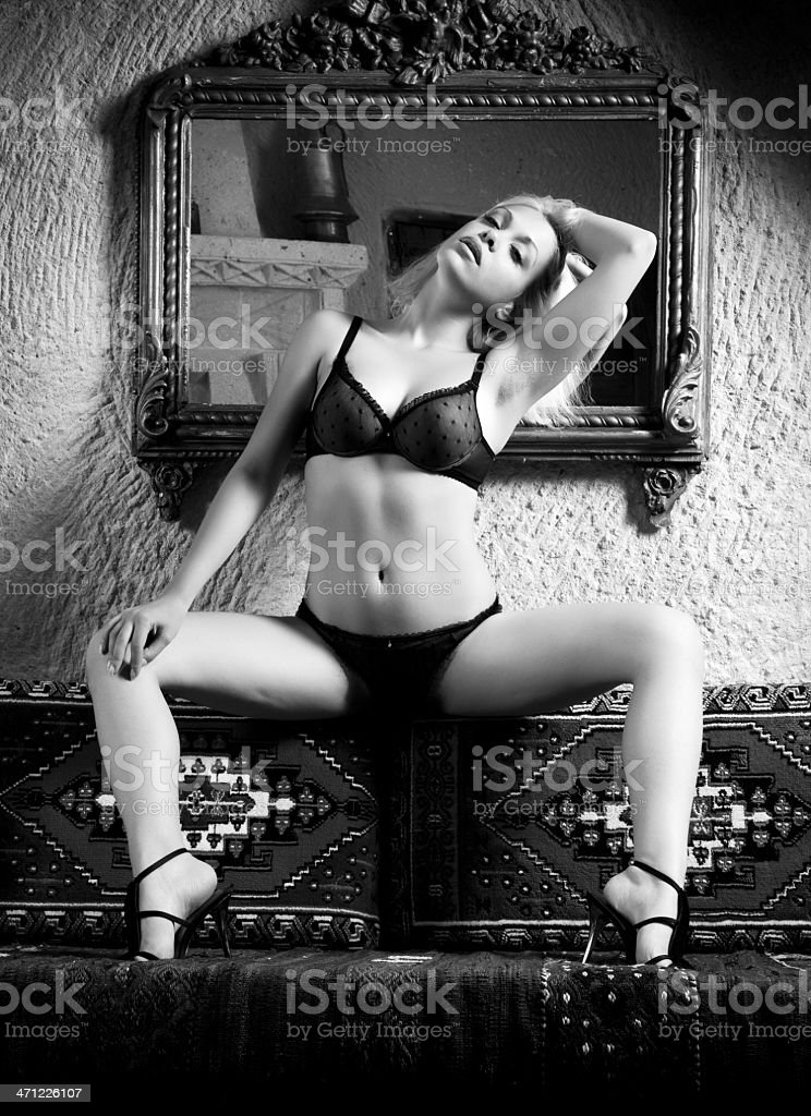 Sexy woman in oriental room stock photo