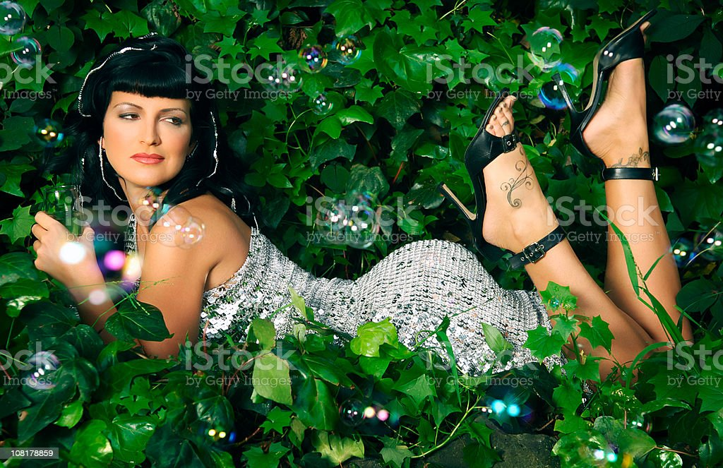 Sexy Woman in Sequined Dress in ivy royalty-free stock photo