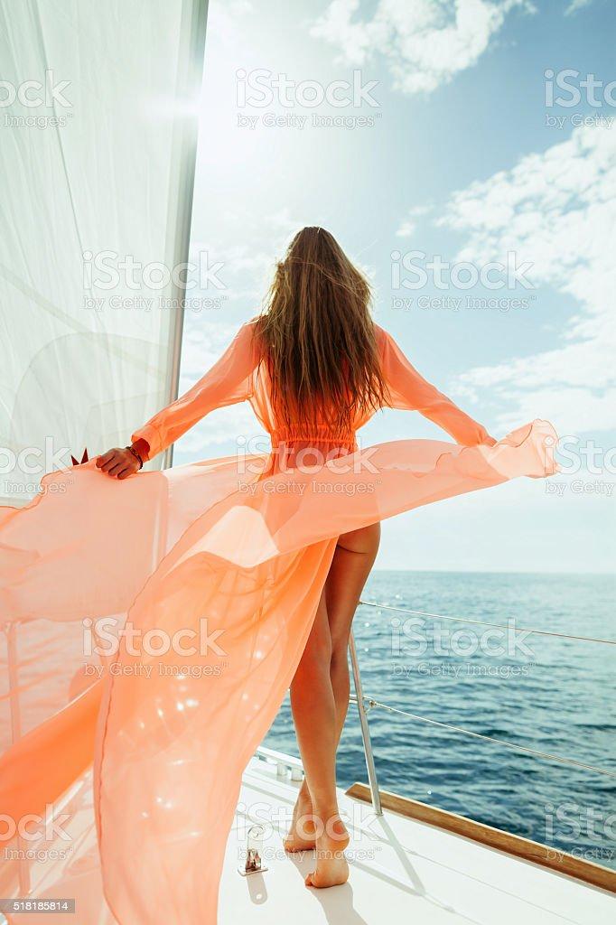 sexy woman in swimwear pareo yacht sea cruise vacation stock photo