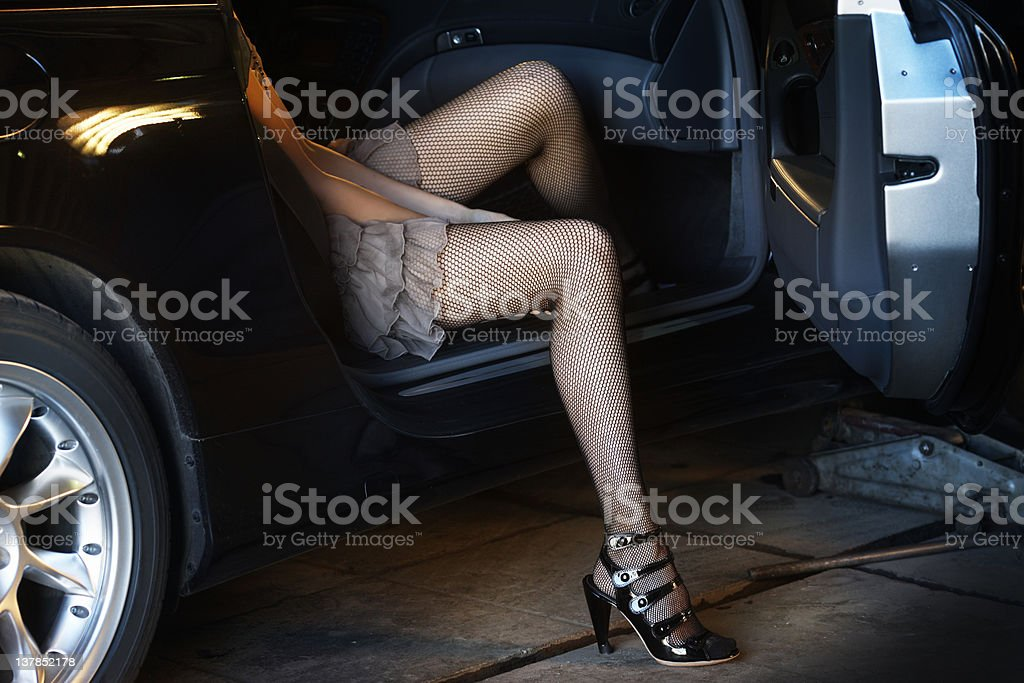 Sexy woman in the car on night road stock photo
