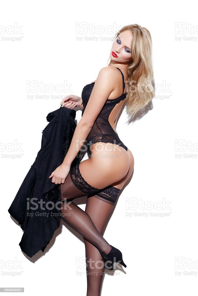 Sexy woman in underwear and coat posing stock photo