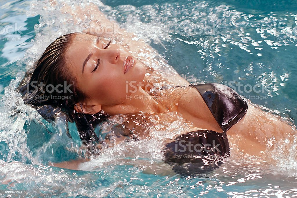 sexy woman is swimming in a pool royalty-free stock photo