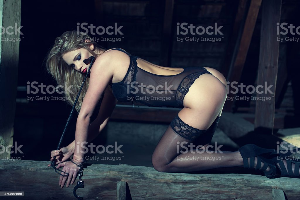 Sexy woman kneeling on the timber in barn stock photo