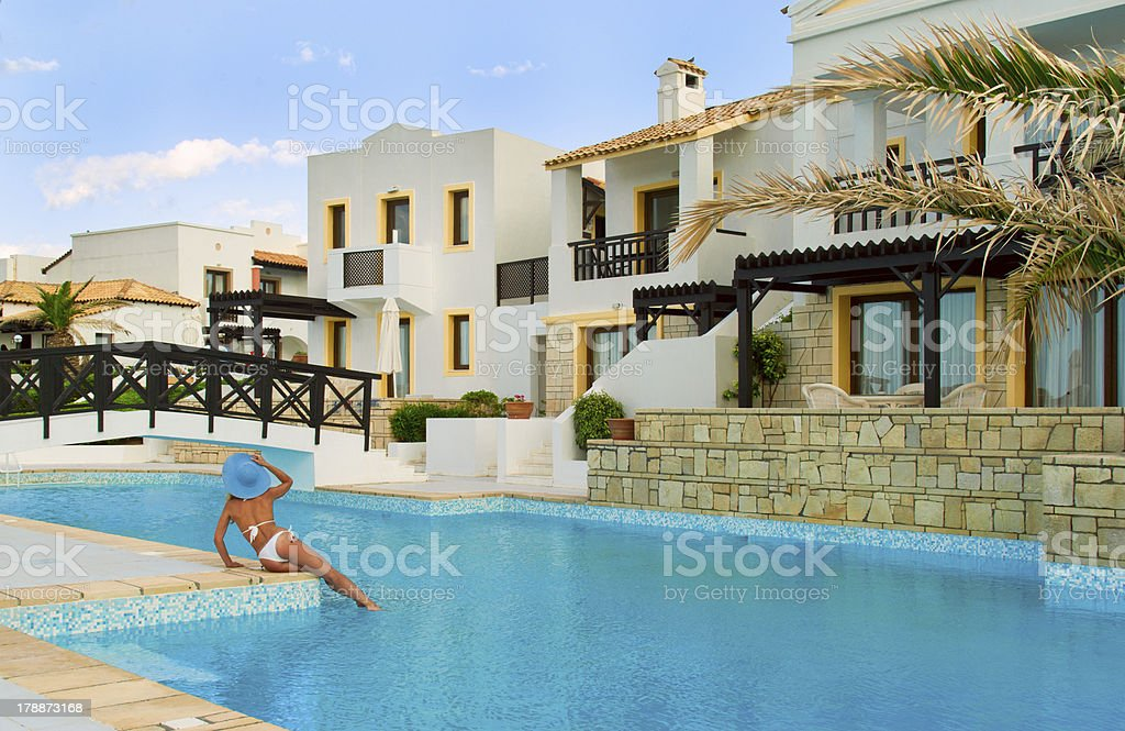 Traditional Greek Houses sexy woman look on traditional greek houses near pool stock photo