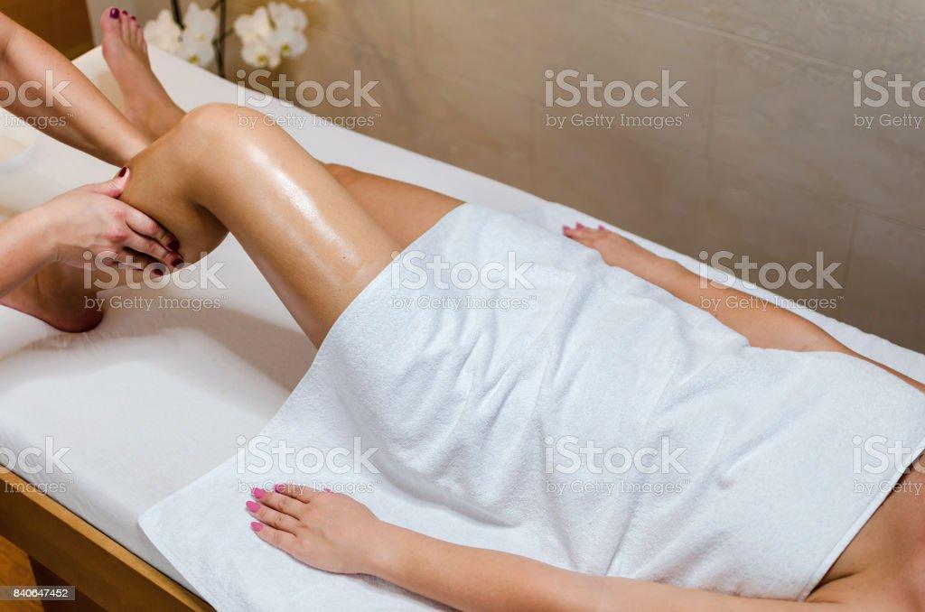 Sexy woman massaging legs stock photo